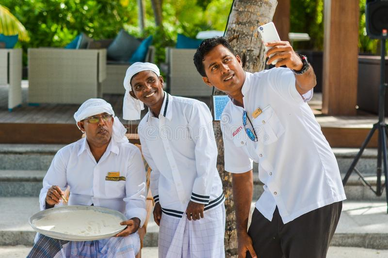 Students taking selfie with muslim maldivian orthography teacher stock photo