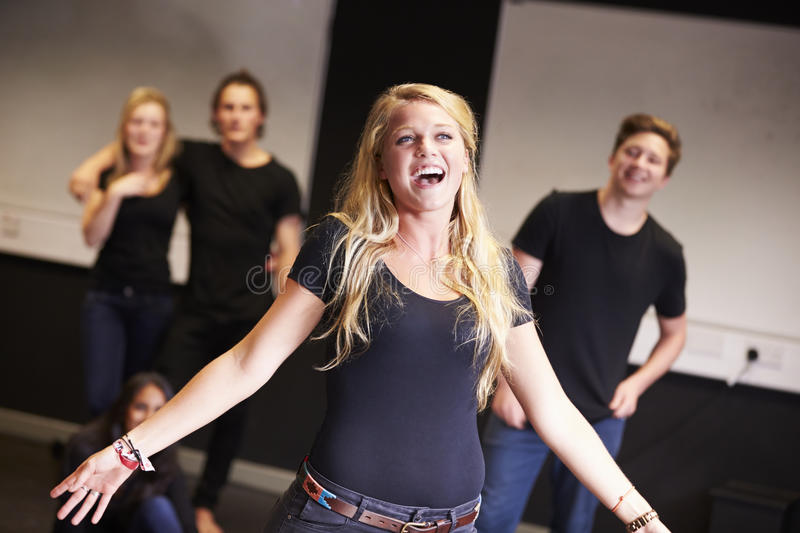 Students Taking Singing Class At Drama College royalty free stock photo