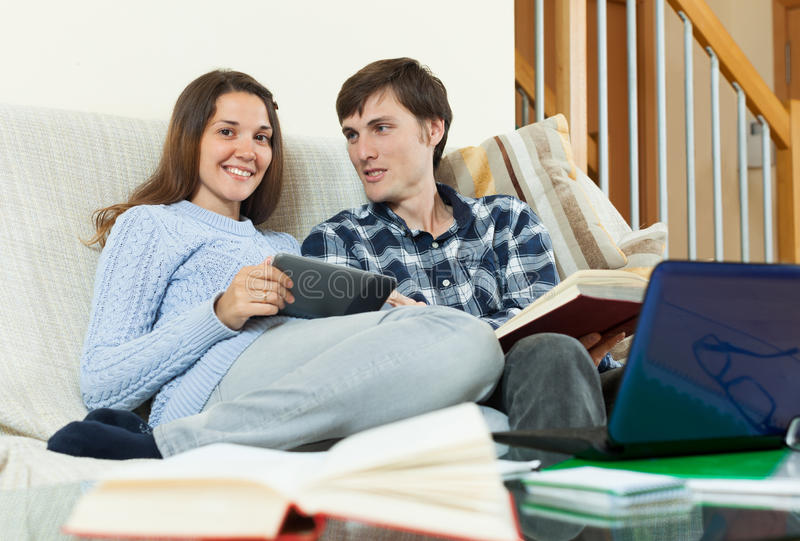 Students talking about exam at home. Two young students talking about the upcoming exam at home royalty free stock photos