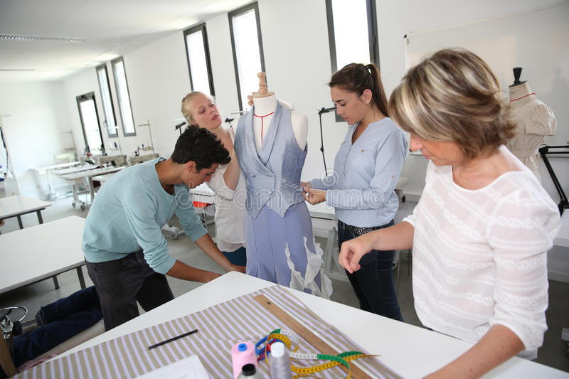 Students with teacher in dressmaking class royalty free stock photo