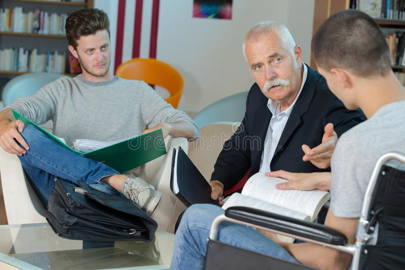 Students and teacher in library royalty free stock image