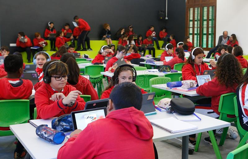 Students in classroom. Students in their classroom in a school in Palma de Mallorca testing a pilot experience creating huge classes with more than 120 students stock image
