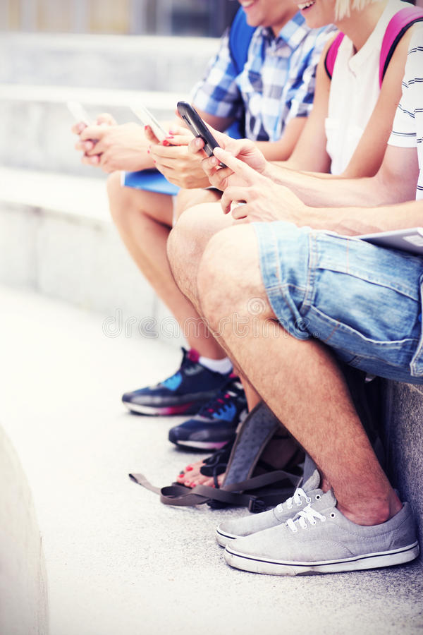 Students And Their Smartphones Stock Photo