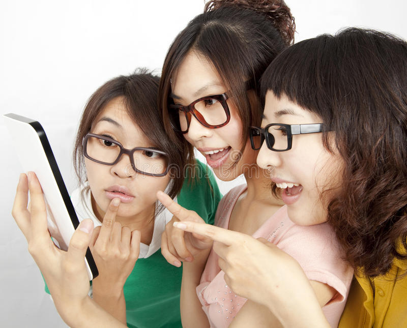 Students with touch screen tablet pc. Three Students with touch screen tablet computer royalty free stock photos