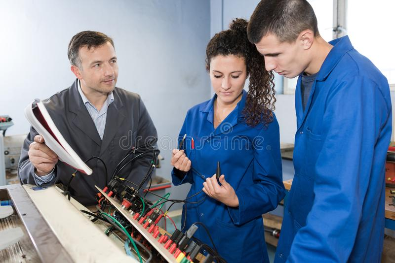 Students training college with electronic components. Students of training college with electronic components royalty free stock photography