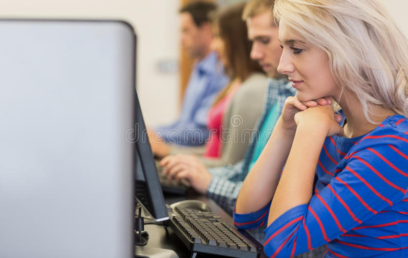 Students Using Computers In The Computer Room Stock Photos