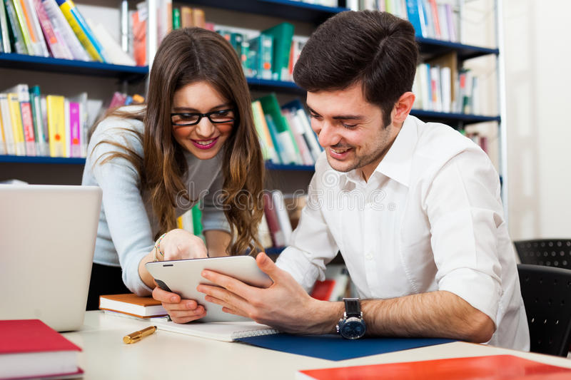 Students using a digital tablet stock image