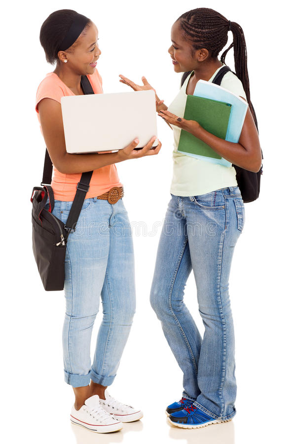 Students using laptop. African college students using laptop together isolated on white background royalty free stock photography