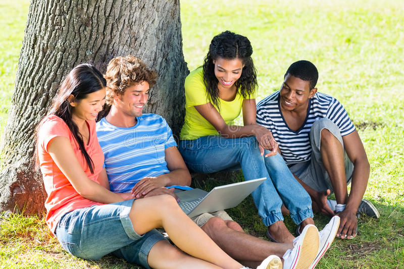 Students using laptop on college campus royalty free stock photography