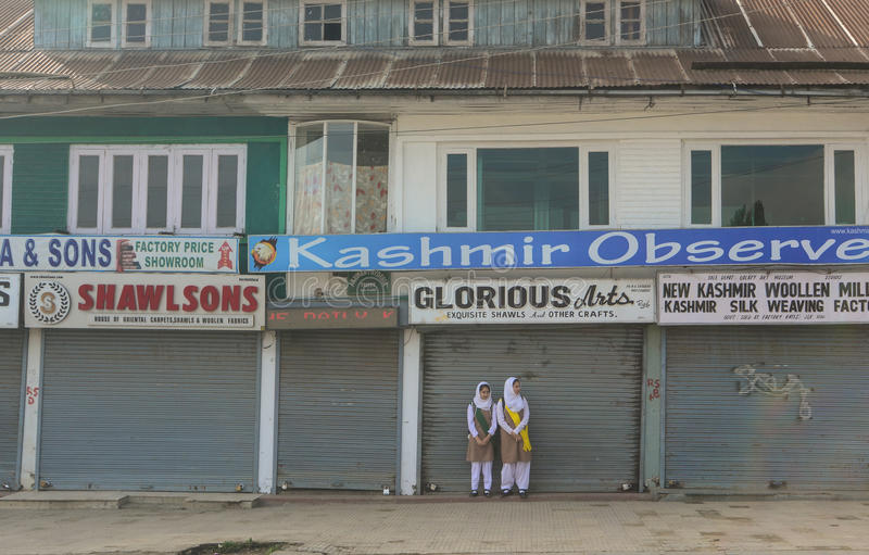 Students waiting for the bus on street in Srinagar, India royalty free stock photography