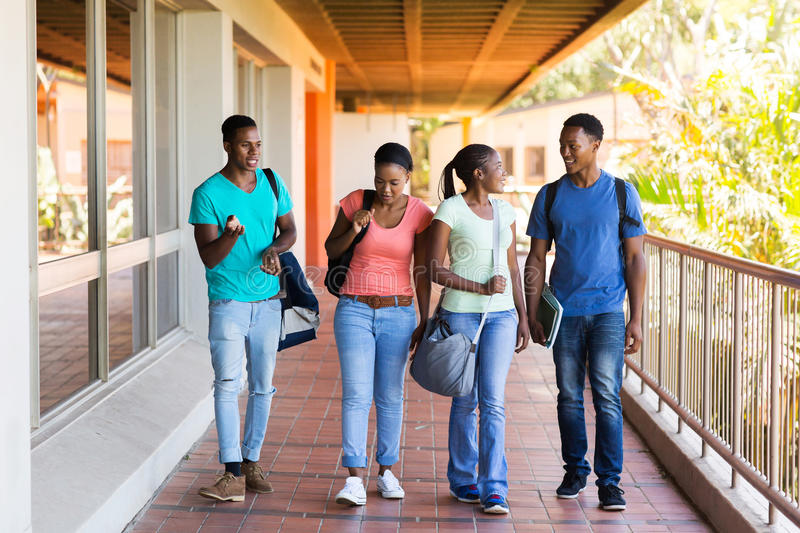Students walking lecture hall. Group of smart college students walking to lecture hall royalty free stock images