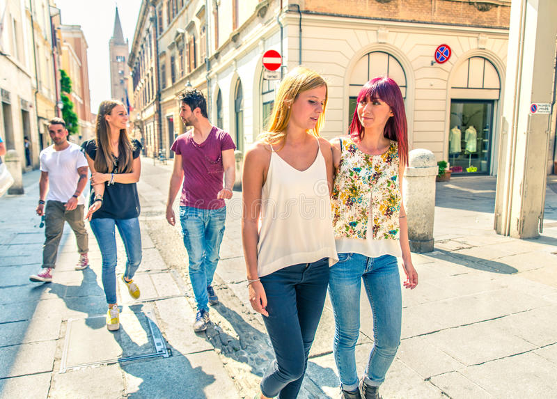 Students walking outdoors royalty free stock photography