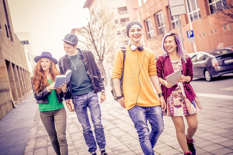 Students walking outdoors stock images