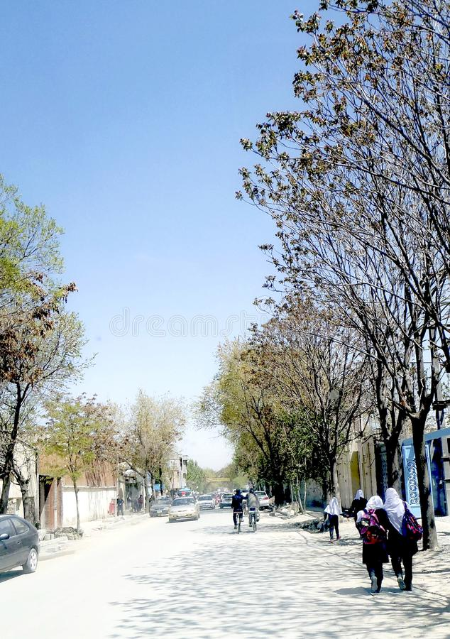 Students were walking to the school in Kabul city, Afghanistan stock photo
