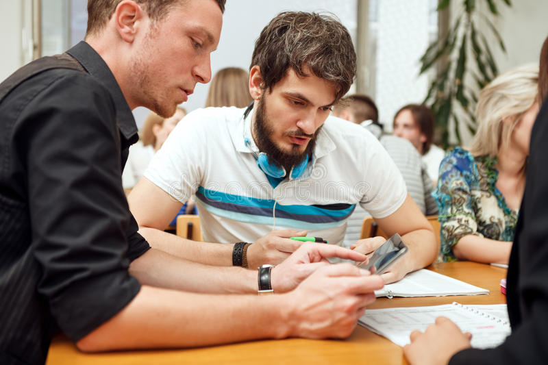 Students working tablet pc stock photography