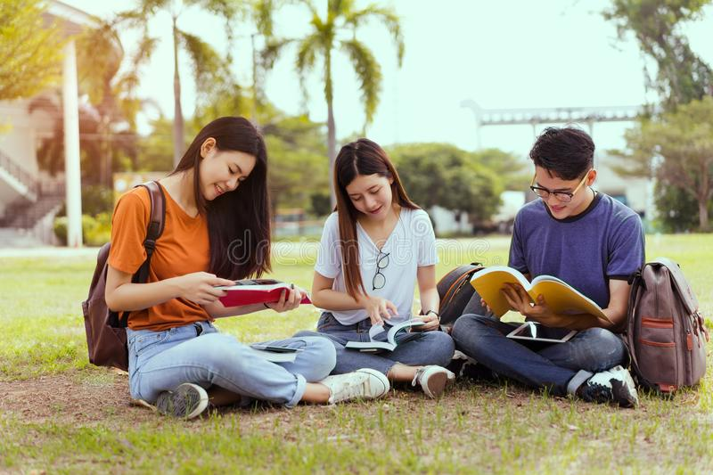 Students young asian together reading book study royalty free stock image
