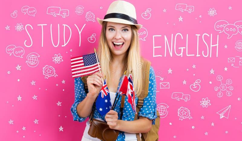 Studie Engelse tekst met jonge vrouw met vlaggen stock afbeeldingen