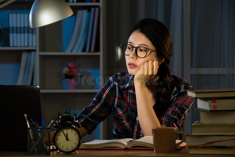 Studies late at night staying up late stock images
