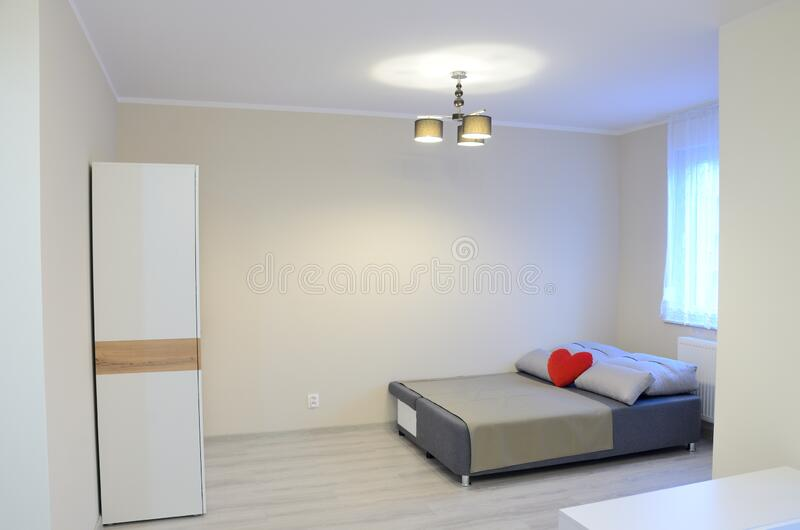 Studio apartment with sofa and wardrobe royalty free stock photography