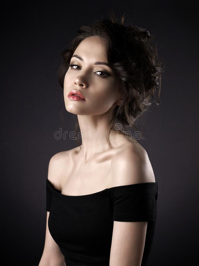 Beautiful woman with elegant hairstyle on black background royalty free stock photos