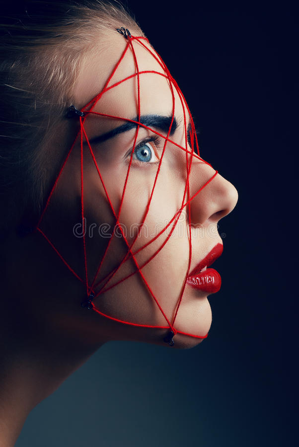 Studio beauty portrait of youg woman with red web royalty free stock image