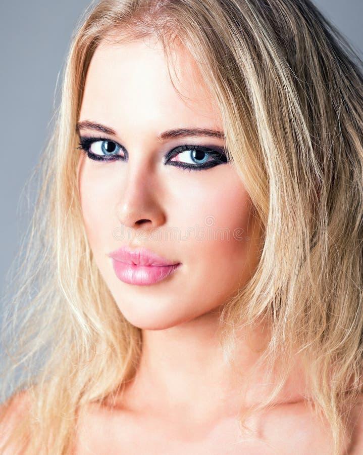 Studio beauty shot: closeup portrait of attractive blonde girl stock image