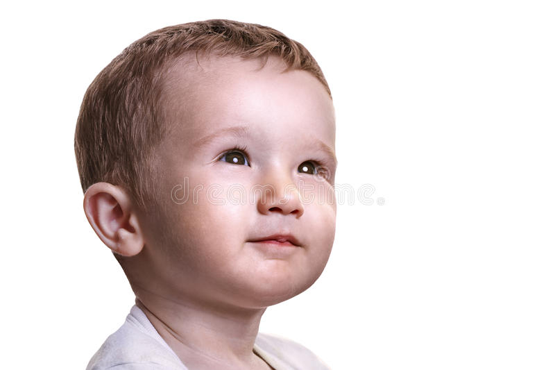 Studio closeup portrait of little baby boy looking full of expectations to the right, isolated on white background royalty free stock photography