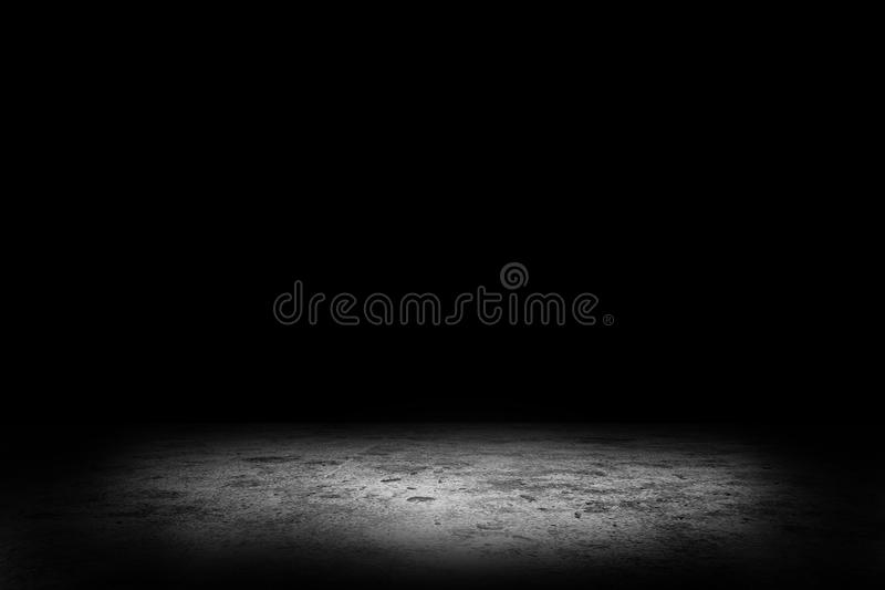 Studio dark room concrete floor texture background with spotlight. Abstract image of Studio dark room concrete floor texture background with spotlight stock photography