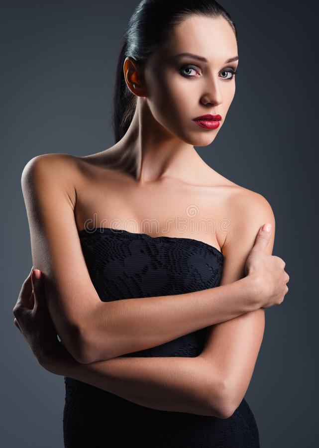 Studio fashion shot: attractive young woman dressed in black royalty free stock photo