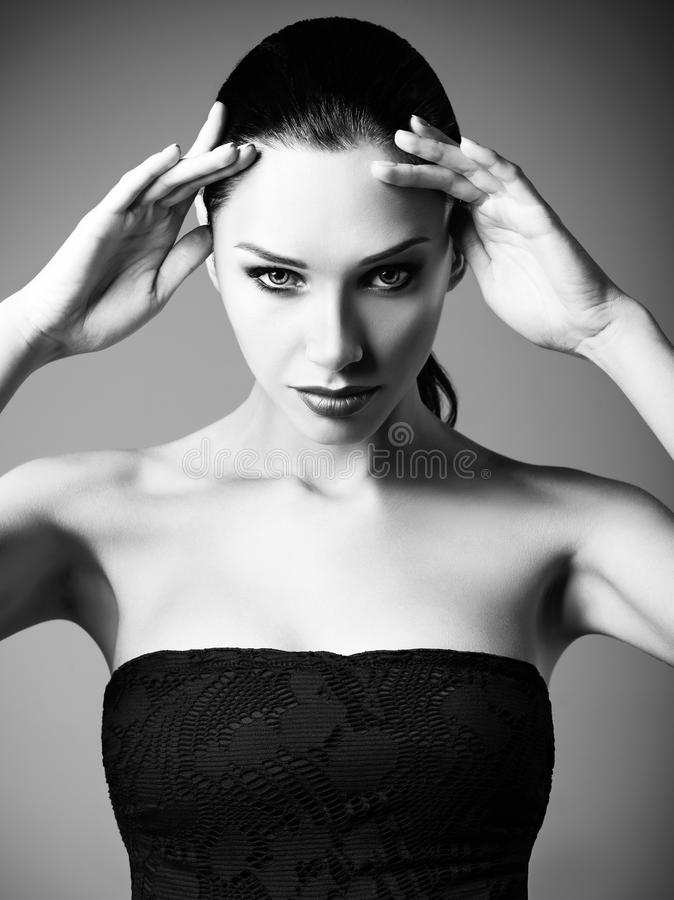 Studio fashion shot: portrait of beautiful young woman. Black and white royalty free stock images