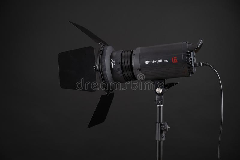 Studio flash is a pulsed light source on black background. Jinbei EF2 100 LED. Studio professional flash is a pulsed light source on black background. Jinbei EF2 stock image