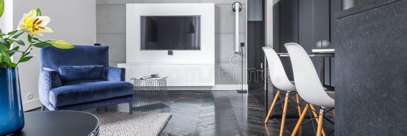 Studio flat with black wardrobe royalty free stock image
