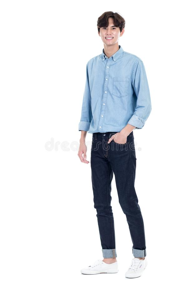 Studio full body portrait of a young asian man stock photo