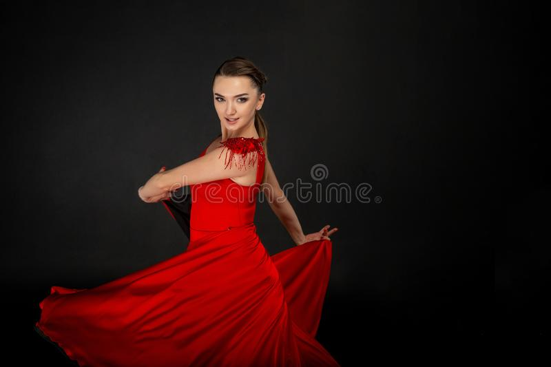 Studio half length portrait of beautiful girl in red dress royalty free stock photo
