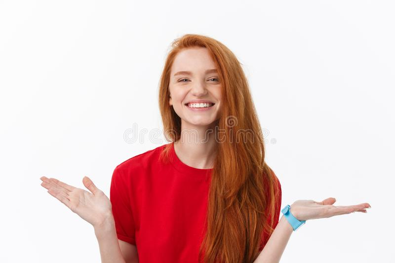 Studio image of cheerful woman playing with hair smiling and laughing, posing over white background. royalty free stock photos