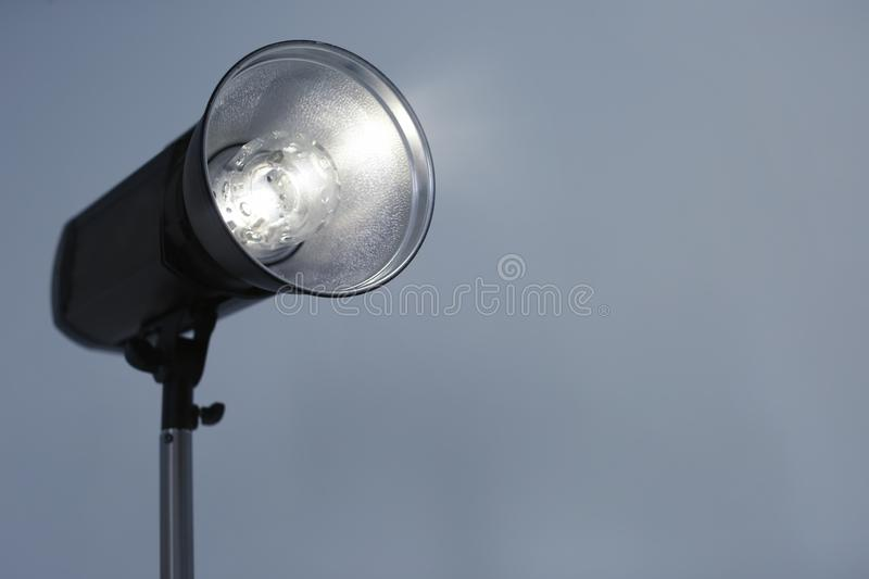 Studio lighting against gray background royalty free stock images