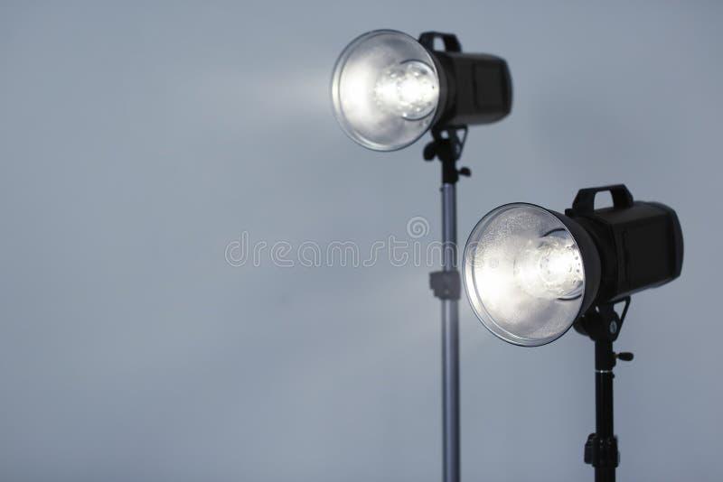 Studio lighting against gray background stock photos