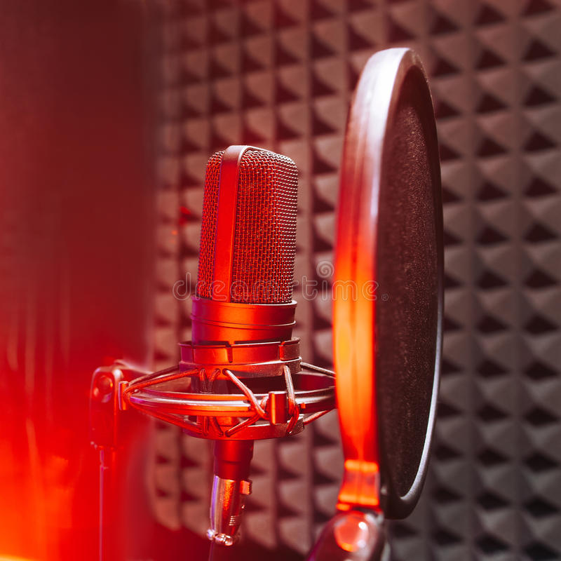 Studio microphone with red on air light royalty free stock photos