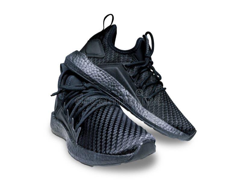 Studio nero delle scarpe atletiche fotografie stock libere da diritti