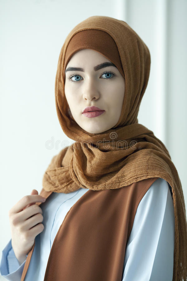 Studio photo of a beautiful young woman dressed oriental type in the Muslim style stock image