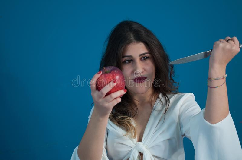Studio photo with cute girl and apple royalty free stock images