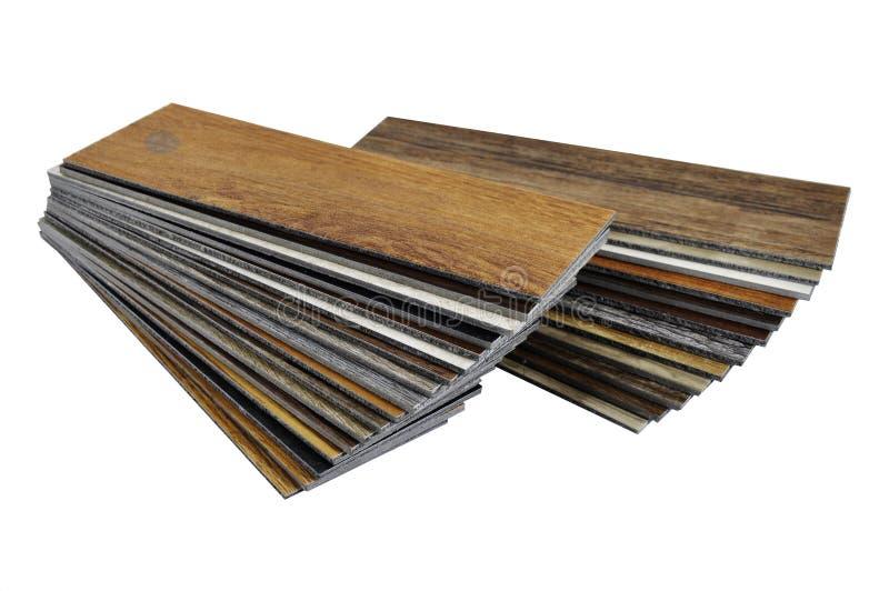 A studio photo of timber laminate flooring accessories. Repair,. Wood texture floor :oak tile, maple tile, chestnut tile, walnut tile, balsam tile, Samples of royalty free stock photos