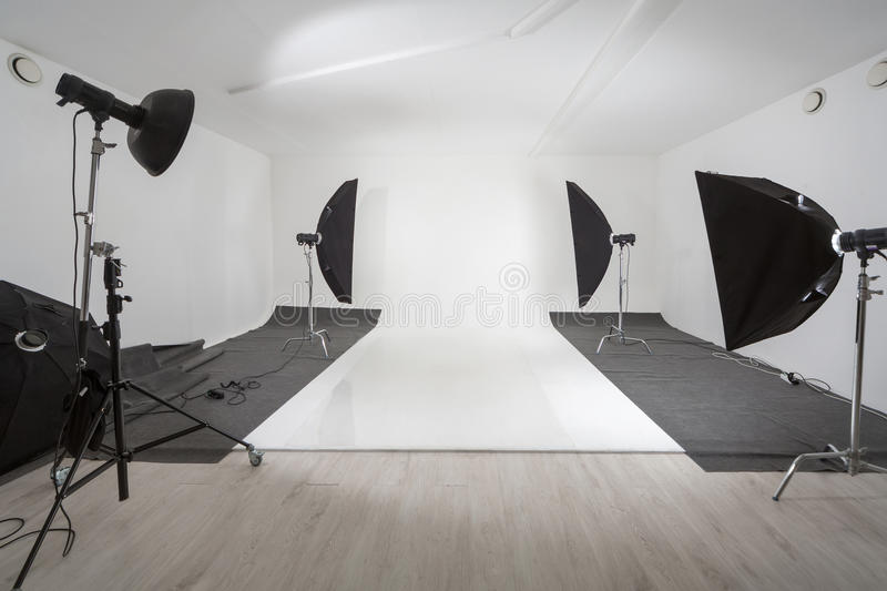 Studio with photographic equipment. And a white backdrop royalty free stock images