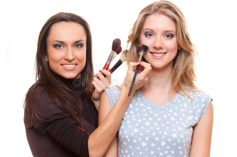 Download Studio Picture Of Smiley Make Up Artist And Client Stock Photo - Image: 24673108