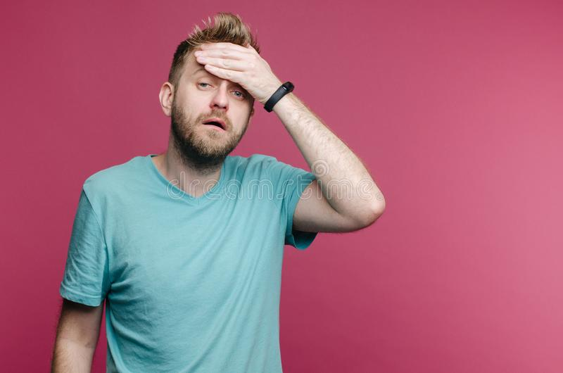 Studio picture from a young man suffering from a headache due to a cold or hangover. Image stock photos