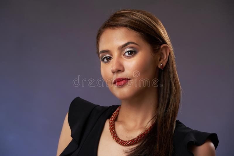 Studio portarit of young woman royalty free stock photography