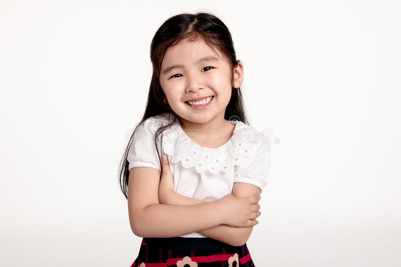 Studio portrait of Asian girl looking happy in front view royalty free stock photos