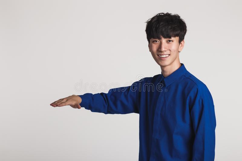 Studio portrait of an asian man posing with hands royalty free stock photography