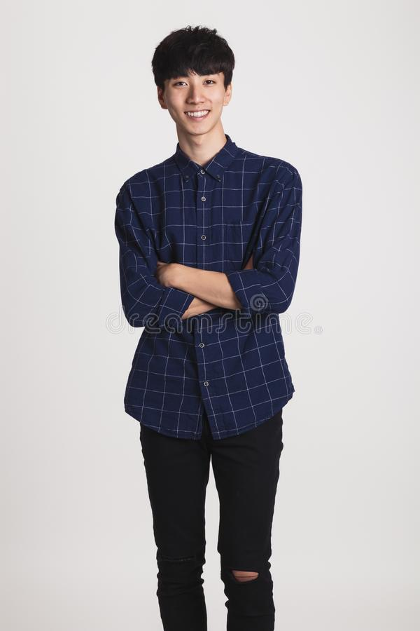 Studio portrait of Asian young man with happy smile and looking at camera royalty free stock images