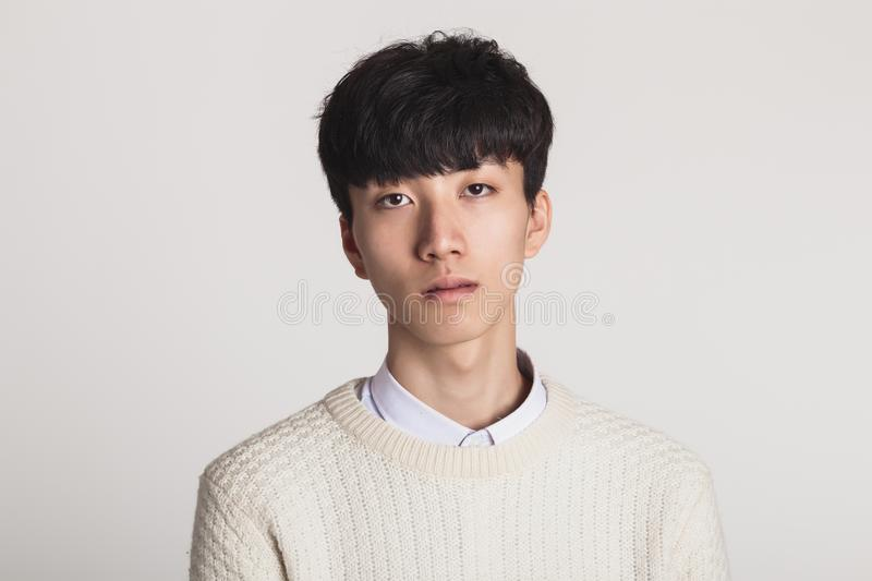 Studio portrait of Asian youth with no motivation royalty free stock photos